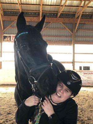Rider nuzzling horse