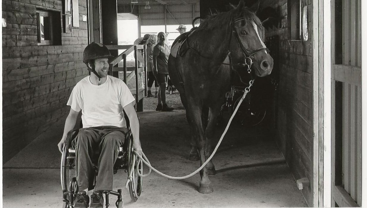 man in wheelchair leading a horse, horse therapy